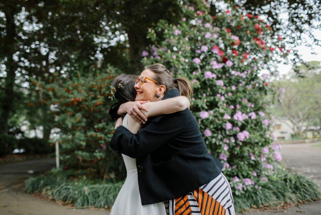 megan hugs bride